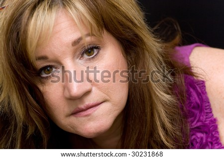 Portrait of a serious looking middle aged woman. - stock photo