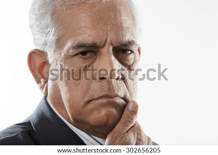 Portrait of a serious man - stock photo