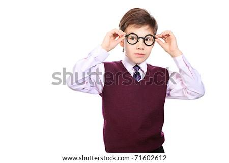 Portrait of a serious schoolboy in a  glasses. Isolated over white background. - stock photo