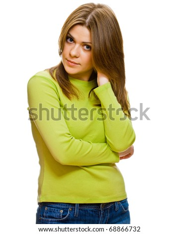 Portrait of a serious young female teen against white background .