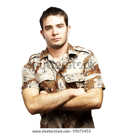 portrait of a serious young soldier standing against a white background - stock photo