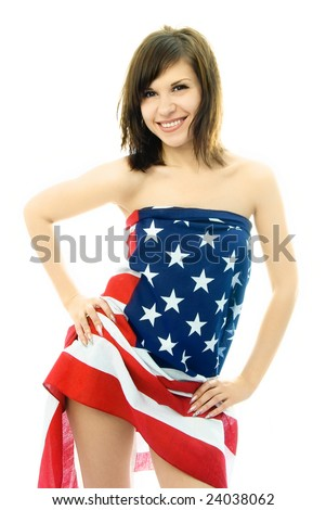 portrait of a sexy beautiful nude woman wrapped into the American flag - stock photo