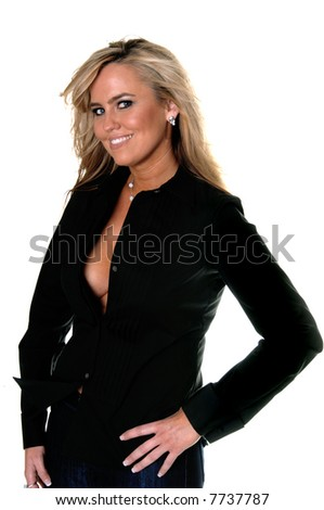 Portrait of a sexy blond woman in jeans and a long sleeve tuxedo shirt