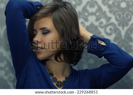 Portrait of a sexy confident brunette - stock photo