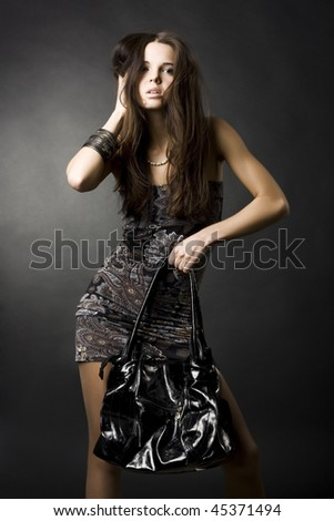 portrait of a sexy girl with a bag - stock photo