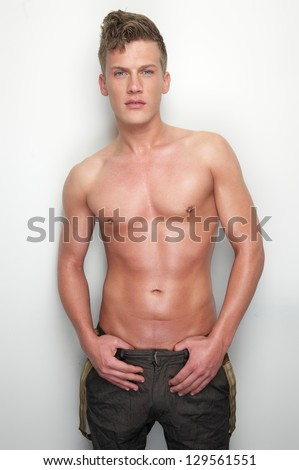 Portrait of a sexy man with no shirt - stock photo