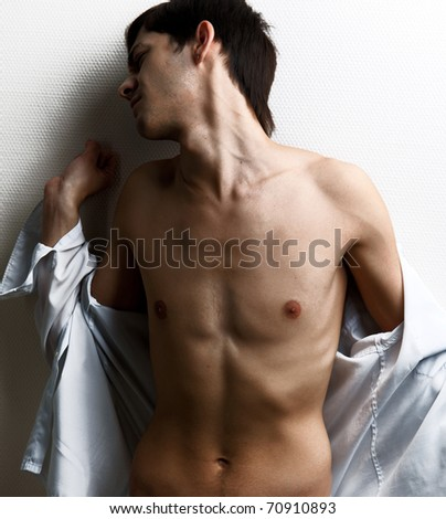 Portrait of a sexy muscular man on gray background