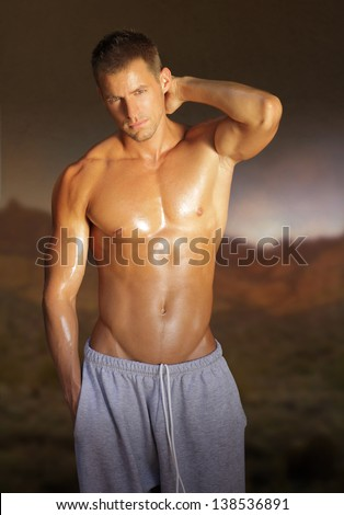 Portrait of a sexy shirtless young man outdoors - stock photo