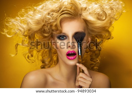 Portrait of a sexy woman with brush - stock photo