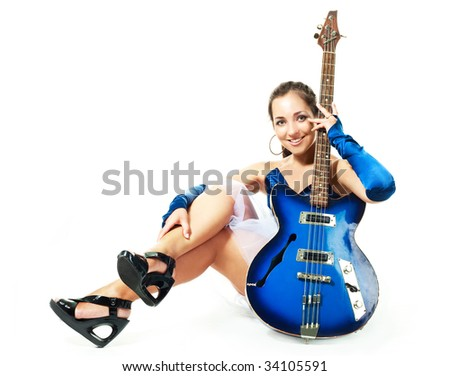 portrait of a sexy young brunette woman with a  guitar - stock photo