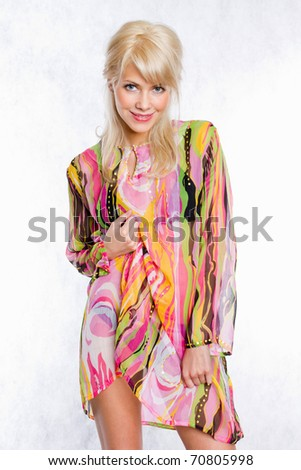 Portrait of a sexy young female fashion model posing against white background - stock photo