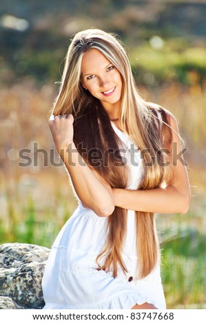 Portrait of a sexy young female smiling in a park - Outdoor - stock photo