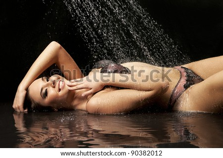 Portrait of a sexy young woman lying under water