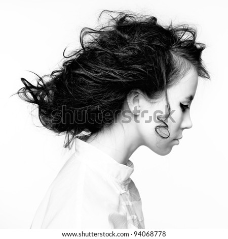 Portrait of a shaggy girl in profile - stock photo