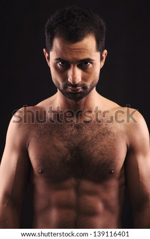 Portrait of a shirtless young man with ripped body - stock photo
