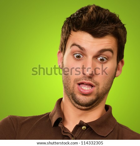 Portrait Of A Shocked Man Isolated On Green Background