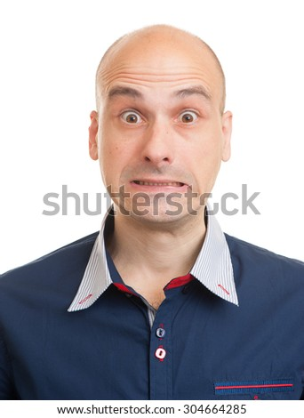 Portrait of a shocked young bald man. Isolated - stock photo