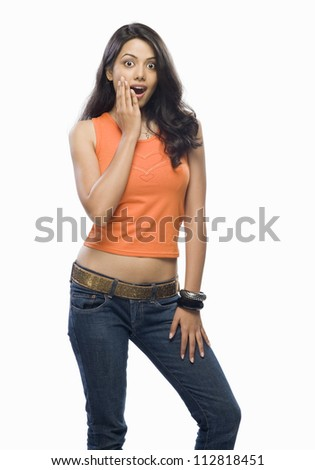 Portrait of a shocked young woman - stock photo