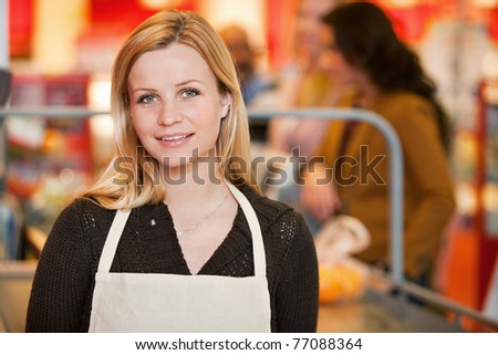 Portrait of a shop owner in the cashier area of the store - stock photo