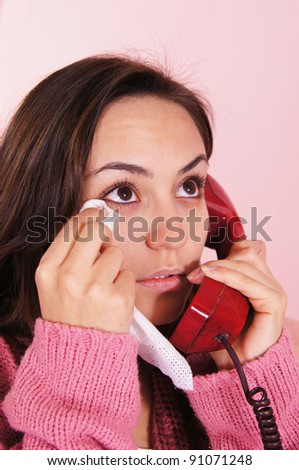 portrait of a sick girl speaking at phone