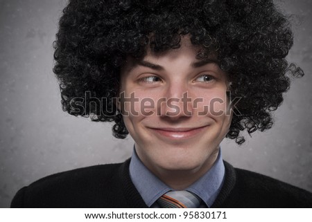 Portrait of a silly young man with curly hair - stock photo