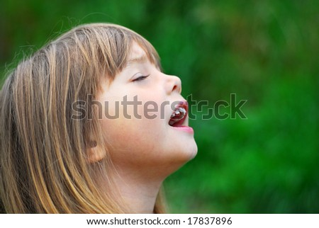 Portrait of a singing cute little girl