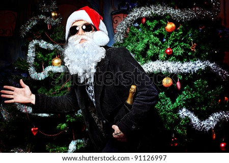 Portrait of a singing Santa Claus with electric guitar. Christmas. - stock photo