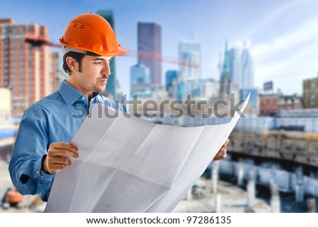 Portrait of a site manager reading a blueprint