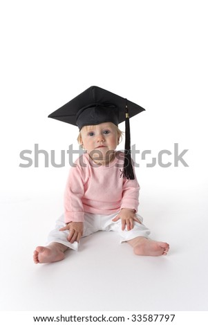 Portrait of a sitting baby with a graduation cap - stock photo