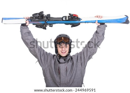 Portrait of a skier in a ski suit and with skis isolated on white background.