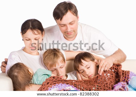 portrait of a sleeping family on a white