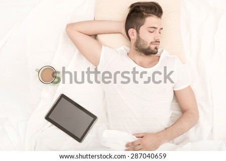 Portrait of a sleeping man from above with coffee.  - stock photo