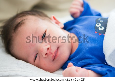 Portrait of a small baby boy - stock photo