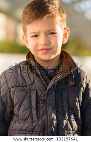 Portrait Of A Small Boy, Outdoors - stock photo