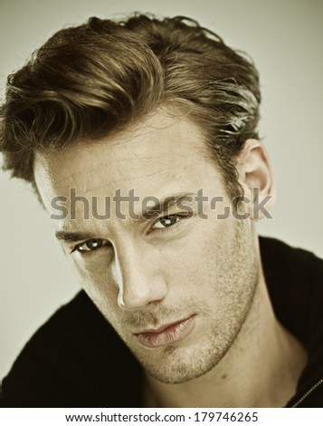 Portrait of a smart and handsome serious young man - stock photo