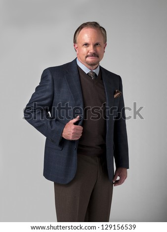 Portrait of a smart mature businessman standing over white background