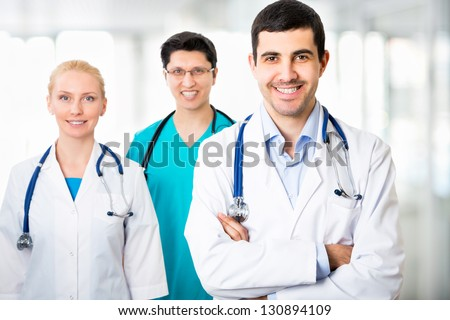 Portrait of a smart young doctors standing in a hospital - stock photo