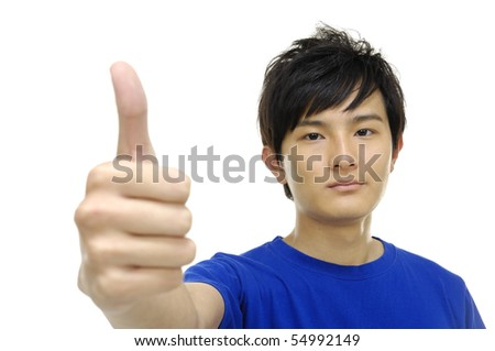 Portrait of a smart young man showing thumbs up - stock photo