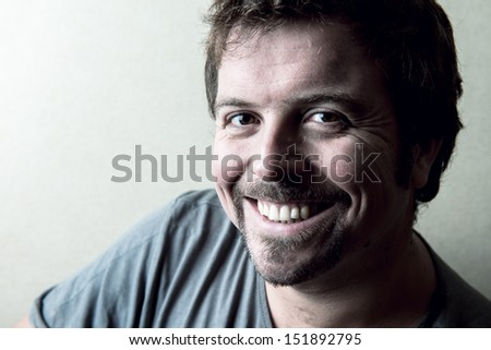 Portrait of a smiley young man - stock photo