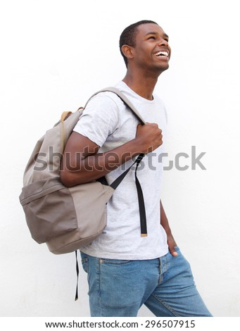 Portrait of a smiling african american male college student walking - stock photo
