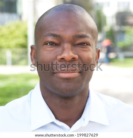 Portrait of a smiling african man - stock photo