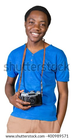 Portrait of a smiling afro american man making photo on retro camera