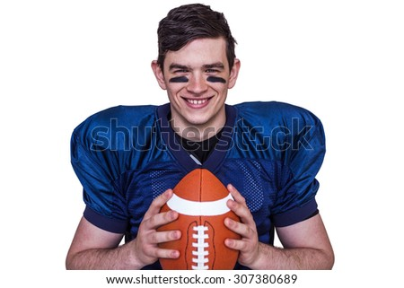 Portrait of a smiling american football player on a white background