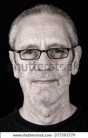 Portrait of a smiling and confident man wearing glasses, with a penetrating gaze - stock photo