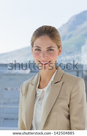 Portrait of a smiling attractive businesswoman in a modern office - stock photo