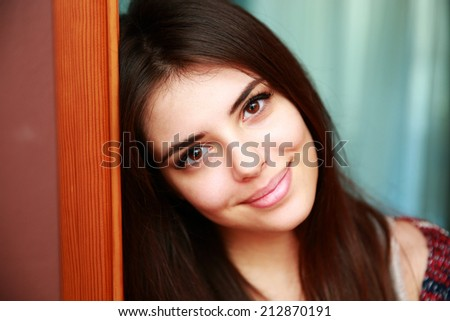 Portrait of a smiling attractive woman at home - stock photo