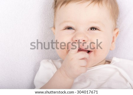 Portrait of a smiling baby - stock photo