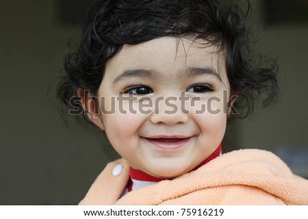 Portrait of a Smiling Baby Girl - stock photo