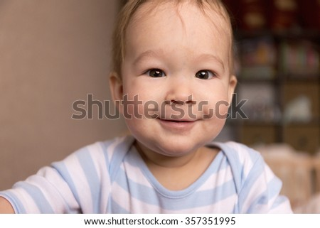 Portrait of a smiling baby 7 months - stock photo