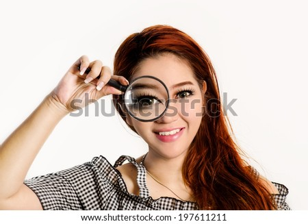 Portrait Of A Smiling Beautiful Asian Woman With A Magnifying Glass, isolated over white. - stock photo